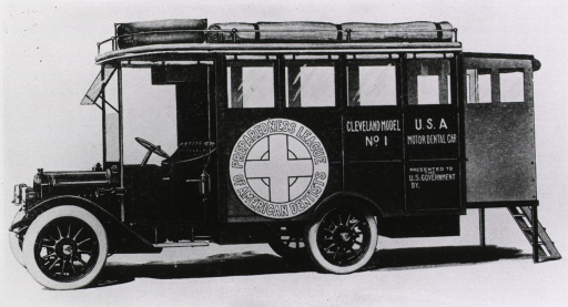 <p>An ambulance with the Preparedness League of American Dentists emblem on the side.</p>