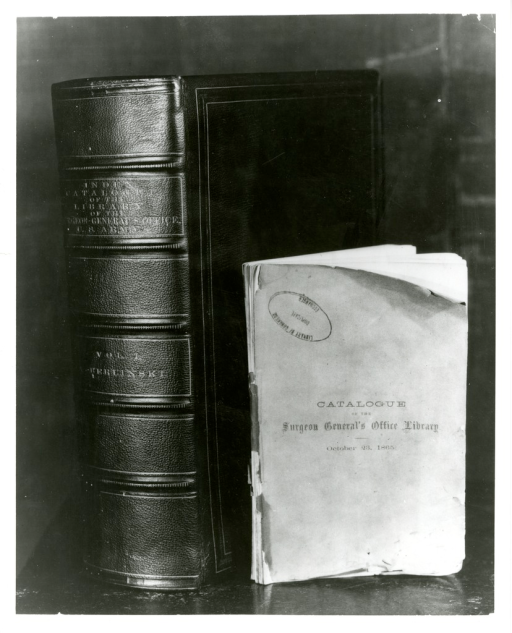 <p>Comparison in size between the Catalogue of the Surgeon General's Office Library from 1865 on the right and the Index-Catalogue of the Library of the Surgeon General's Office from approximately 1873-1874.</p>