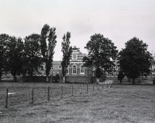 <p>Exterior view of the grounds and buildings of the 36th Station Hospital.</p>