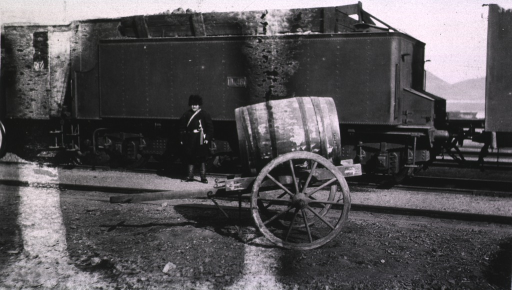 <p>A water cart is located near a train used along the Trans.-Siberian Railroad.  A soldier stands beside the train.</p>