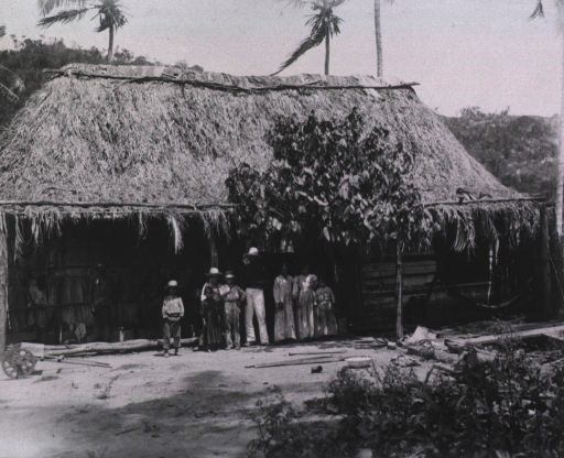 <p>A Cuban family of ten members stand in front of their hut.</p>