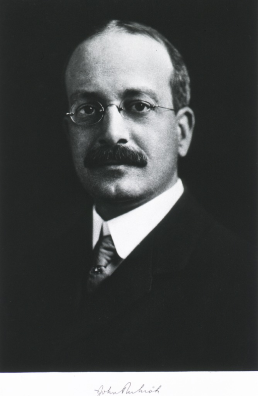 <p>Head and shoulders, front pose, wearing glasses.</p>