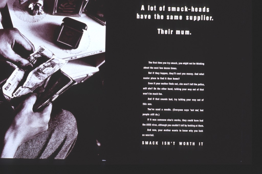 <p>Predominantly black poster with white lettering.  All text on right side of poster.  Lengthy caption discusses stealing from home and possible consequences, as well as dangers of using another's needle to shoot up.  Visual image on left side of poster is a reproduction of a b&amp;w photo showing a person rooting through a wallet for cash.  The person has more than ℗Đ20 already out of the wallet.</p>