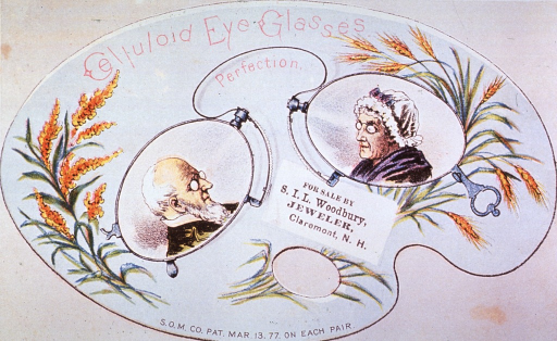 <p>Advertising card: A pair of spectacles set against an artist's palette with stalks of wheat at the right and left extremities. An old man and an old woman are pictured in the lenses.</p>