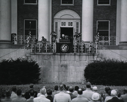 <p>Showing Dr. Dyer (head and shoulders, left profile) at the podium.</p>