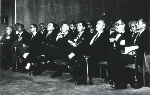 <p>Shown seated in an audience are Dr. Philip Lee, Dr. John Sherman, Dr. Stuart Sessoms, Dr. William Stewart, Dr. James A. Shannon, and Mr. John Gardner.</p>
