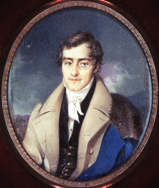 <p>Half-length, left pose, full face, wearing glasses, blue fur-collared cloak over left shoulder. A miniature in an oval brown and gold frame.</p>