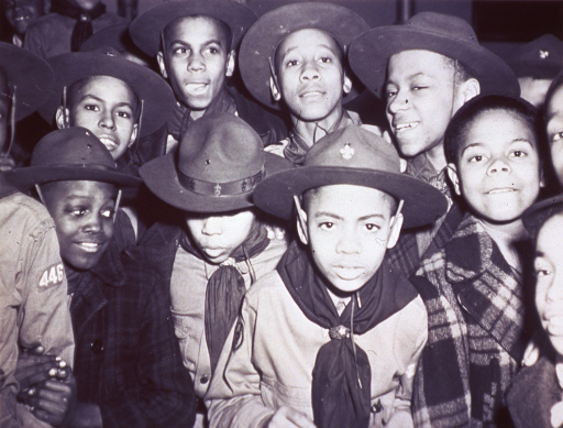 <p>Group portrait, facing front, of African-American boys, most in Boy Scout uniforms.</p>