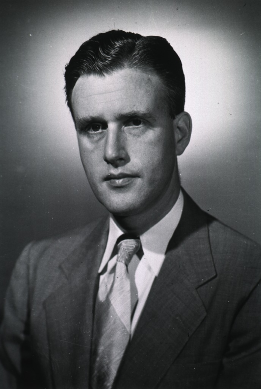 <p>Head and shoulders, front pose, wearing civilian clothing.</p>