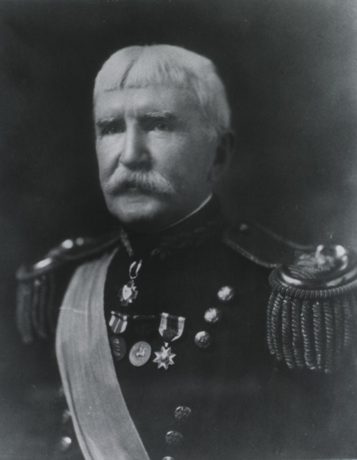 <p>Head and shoulders, left pose, wearing ribbon from shoulder and epaulettes.</p>