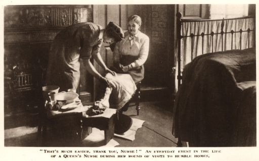 <p>Postcard featuring a black and white photograph of a Queen's nurse treating a woman's leg in her home.</p>