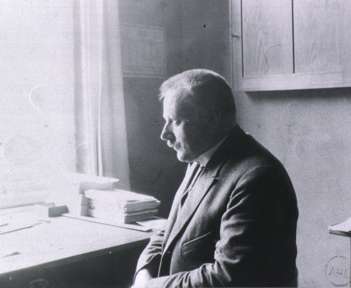 <p>At his desk in Lab. at the Physiological Inst. Halle. 1923.</p>