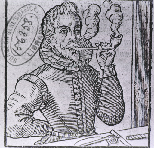 <p>A man is smoking a long-stemmed pipe; another pipe and a roll of tobacco are on a table in front of him.</p>