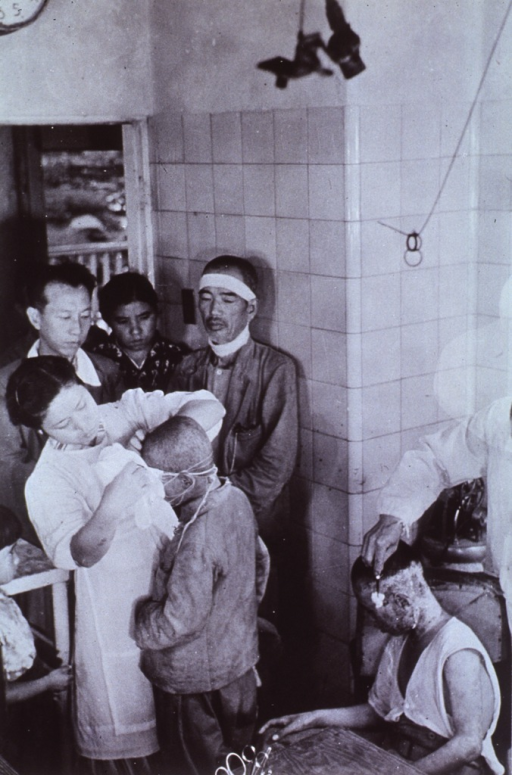 <p>Interior view of the Surgical Treatment Room, Department of Communications, (Post Office) Hospital.  Injured receiving treatment for burns.</p>