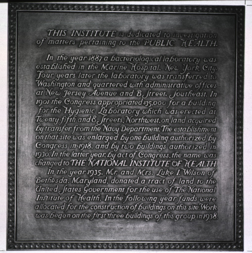 <p>Showing plaque in Building 1 lobby.</p>
