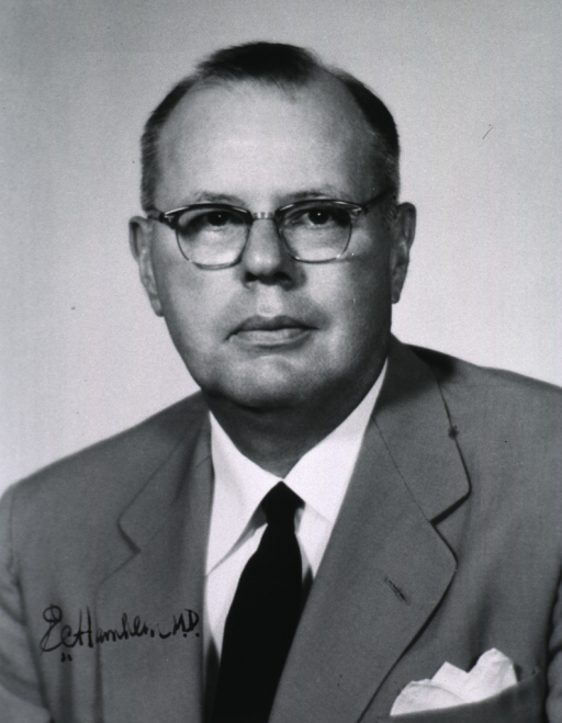 <p>Head and shoulders, full face; wearing glasses.</p>