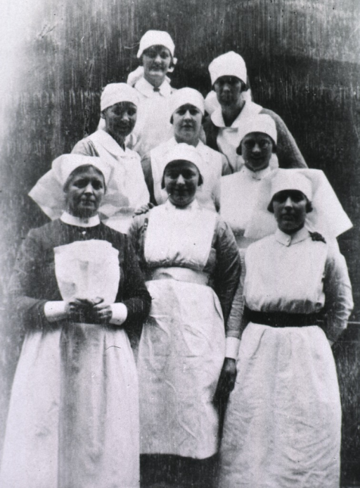 <p>Seven midwifery students gather with Sister Moira.</p>
