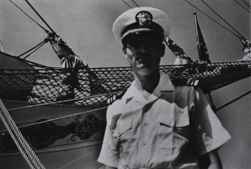 <p>Half-length, turned slightly to the left, full face; wearing uniform and cap; PHS ship &quot;Eagle&quot; is in the background.</p>