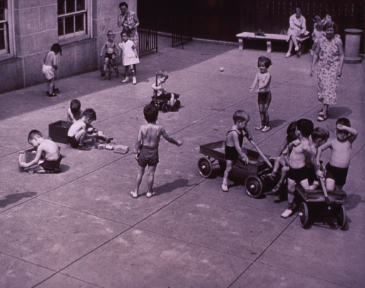<p>Children at play outdoors at Robert White Fund Health Unit, WPA nursery school, South Boston, Massachusetts.</p>