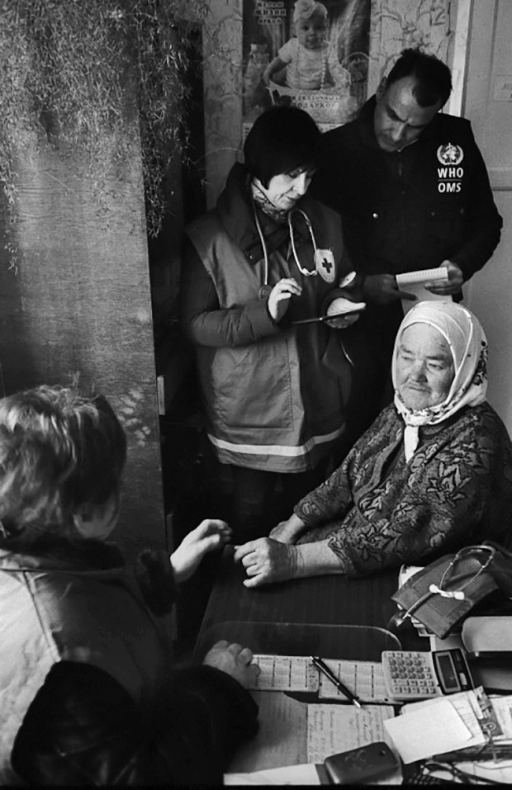 This 70-year-old woman, who was relocated from her home in Donetsk, is being examined in the Kharkiv region by a health worker from the Ukrainian Red Cross.
