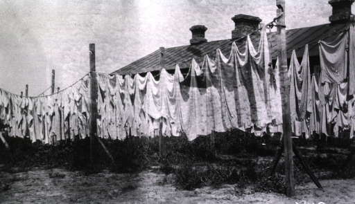 <p>Laundry hangs on clotheslines outside a hospital in Harbin.</p>