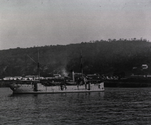 <p>View of the gunboat Machias with the town of Siboney in the background.</p>