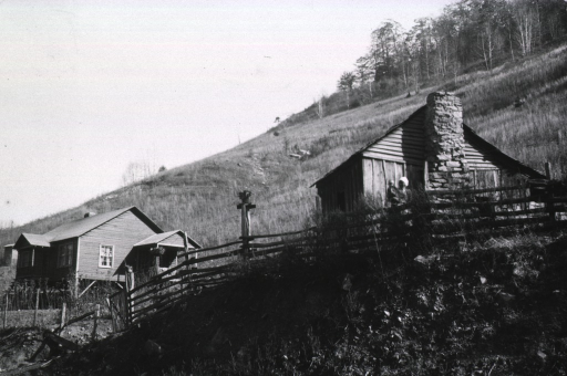 <p>Exterior view showing two houses on a hillside.</p>