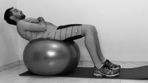 Crunch or curl-up with Swiss ball