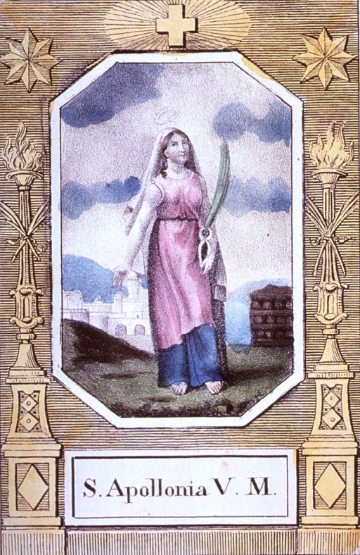 <p>Full length, standing, right pose; holding pincers and palm frond; buildings in background.</p>