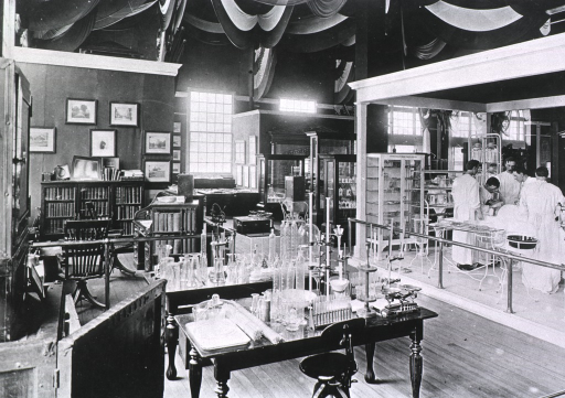 <p>View of interior of exhibit hall at the Jamestown Ter-centennial Exposition, probably in the Government Building, East, showing U.S. Public Health and Marine Hospital Service exhibits; visible exhibits include lab tables, offices, and a model of an operating room at a Marine Hospital depicting surgeons at work.</p>