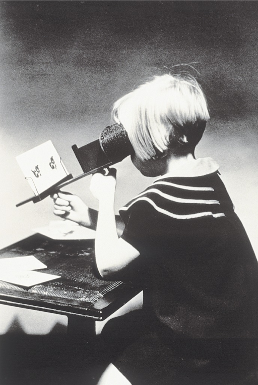 <p>Image of a young girl doing corrective exercises for strabismus, using a stereoscope.</p>