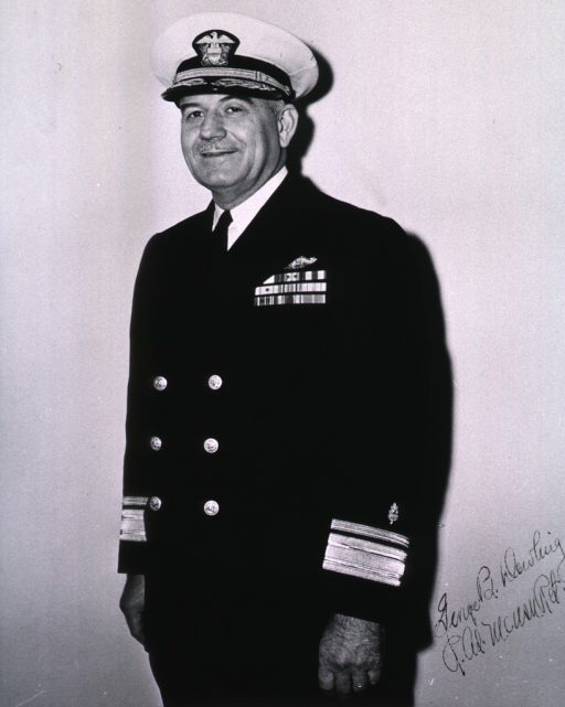 <p>Standing, full face, wearing uniform and cap (Rear Admiral).</p>