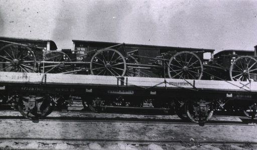 <p>A view of hospital carts on a railroad train bed.</p>
