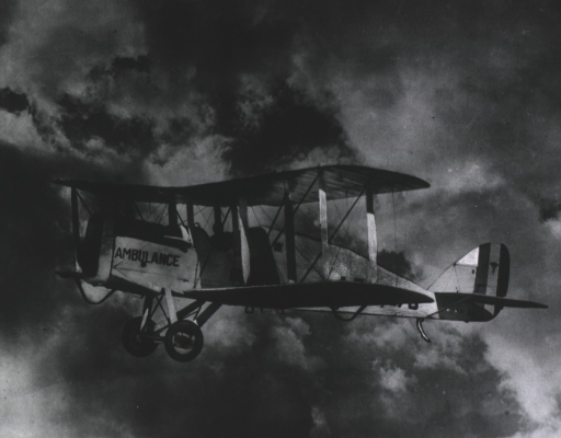 <p>Large photo of a World War I airplane ambulance in flight over Langley Field.</p>