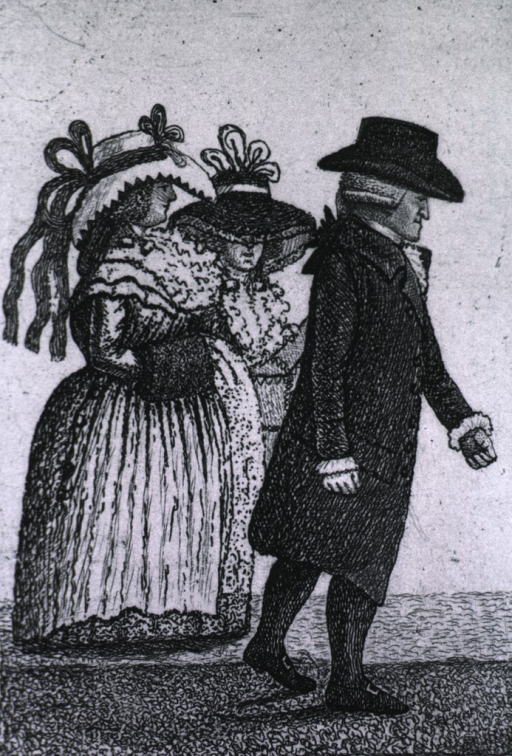 <p>Full length, right profile, wearing hat and coat, walking; also shown are two women standing in the background.</p>