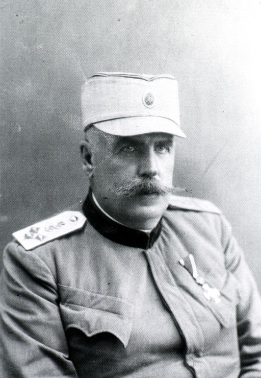 <p>Head and shoulders, right pose.  In uniform and cap.</p>