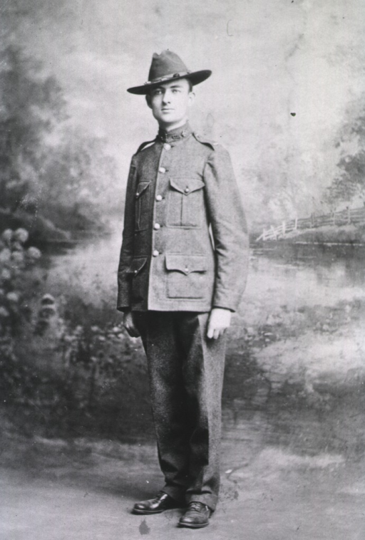 <p>Full length, standing, wearing khaki uniform and hat.</p>