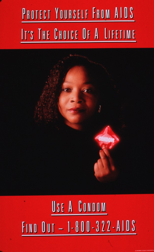 <p>Poster with wide red border at the top and bottom. The middle section consists of the photo reproduction of a young African American female wearing a black sweater and holding a condom in red packaging. The photo is from the shoulders up and is against a black background. A phone number to obtain further information is provided.</p>