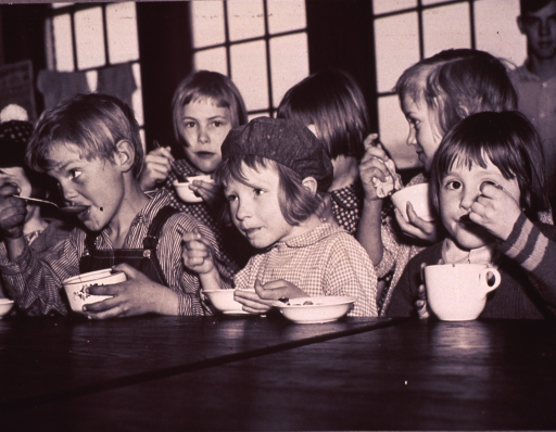 <p>Children are eating soup for lunch; each child is eating from a different shaped bowl or mug.</p>