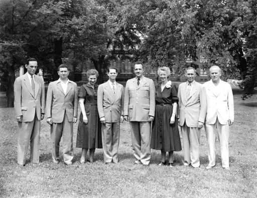 <p>Colonel Frank B. Rogers (center), Director and Chief Librarian of the Armed Forces Medical Library, stands with 7 division chiefs. From left to right: Mr. S. Lazerow, Seymour I. Taine, Estelle Brodman, Kanardy L. Taylor, M. Ruth MacDonald, Joseph Tucker, Claudius F. Mayer.</p>