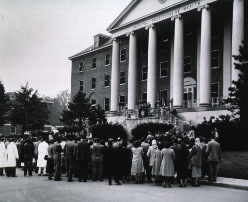 <p>View from behind audience, showing front of Building 1.</p>