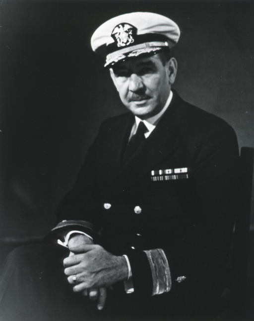 <p>Three-quarter length, seated, left pose, full face; wearing uniform and cap.</p>