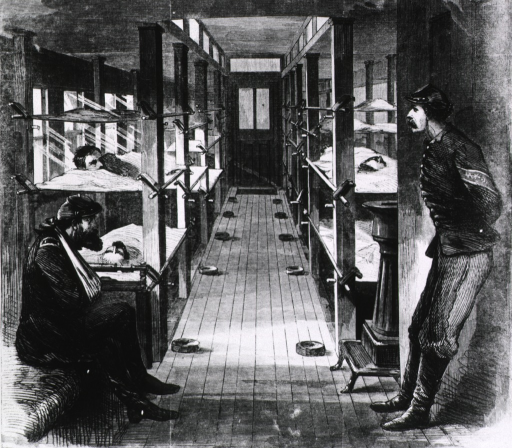 <p>Interior of a hospital car - showing stretchers on racks suspended by India rubber bands.</p>