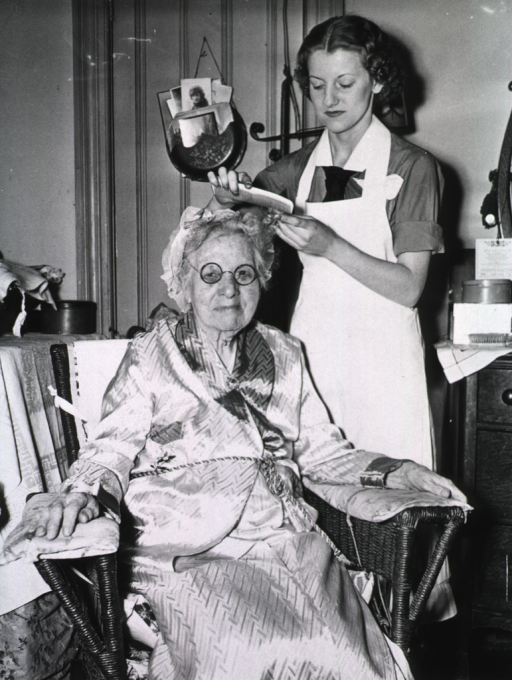 <p>Showing a nurse providing general grooming for an elderly woman.</p>