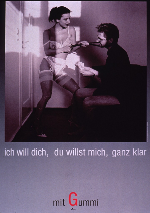 <p>The poster shows a photo reproduction of a male-female couple in a small bedroom. The woman is standing in front of the man, wearing lacy underwear, garters, stockings, and heels. The man is seated on the bed fanning out bills of money. The woman is grasping both ends of a tie or belt which has been looped around the man's neck. The remainder of the poster is a gray background with the &quot;G&quot; in Gummi in bright pink.</p>