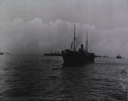 <p>View of an United States transport carrying soldiers to Santiago.  Other ships are in the background.</p>