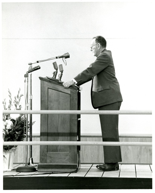 <p>Dr. Worth Daniels speaks at the podium at NLM Dedication Ceremony in December, 1961.</p>