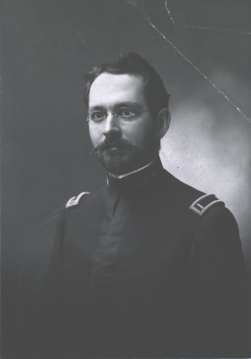 <p>Left pose, wearing uniform, beard.</p>