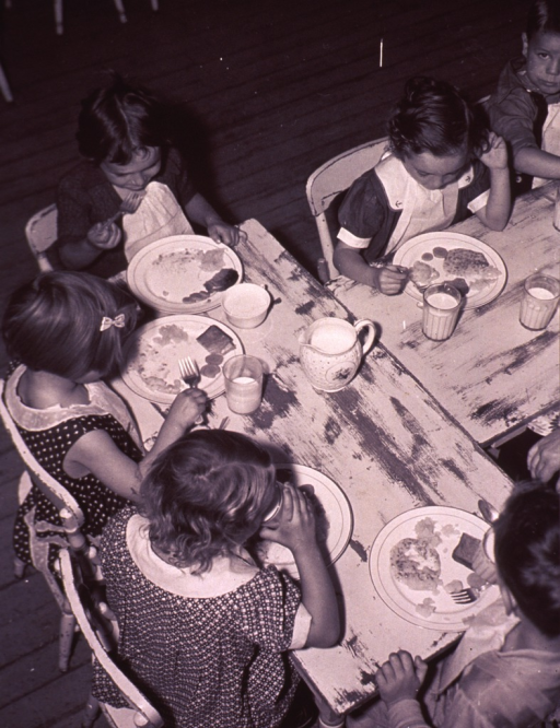 <p>Overhead view of children eating lunch in a school cafeteria.</p>