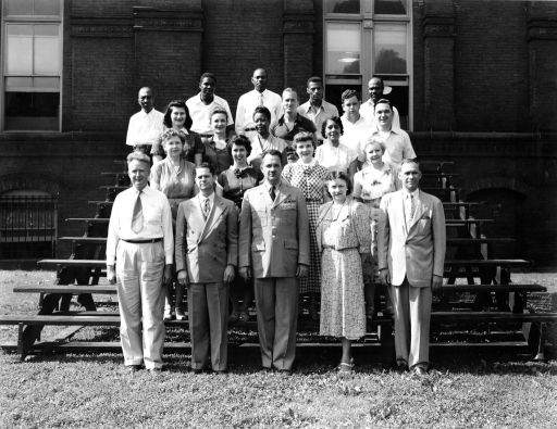 <p>Colonel Frank B. Rogers, Director of the Armed Forces Medical Library, stands with the Administrative Division.  Front Row: Mr. George B. Hall, Mr. Kanardy L. Taylor, Colonel Frank B. Rogers, Mrs. Ethel M. Chase, Mr Joseph Tucker. 2nd Row: Mrs. Luella D. Scott, Miss Florence H. Barrette, Miss Maureen M. Markley, Mrs. Aldine D. Mudd. 3rd Row: Mrs. Mary M. Koehler, Mrs. Margaret T. Reese, Mrs. Lee E. Dean, Mrs. Sarah C. Jenifer, Mr. Toni Mancini. 4th Row: Mr. William L. Carrick, Mr. Joseph McGroarty. 5th Row: Mr. Herbert Smith, Mr. Patrick Patterson, Mr. Enas Broadway, Mr. Clinton E. Scott, Mr. James D. Carr.</p>
